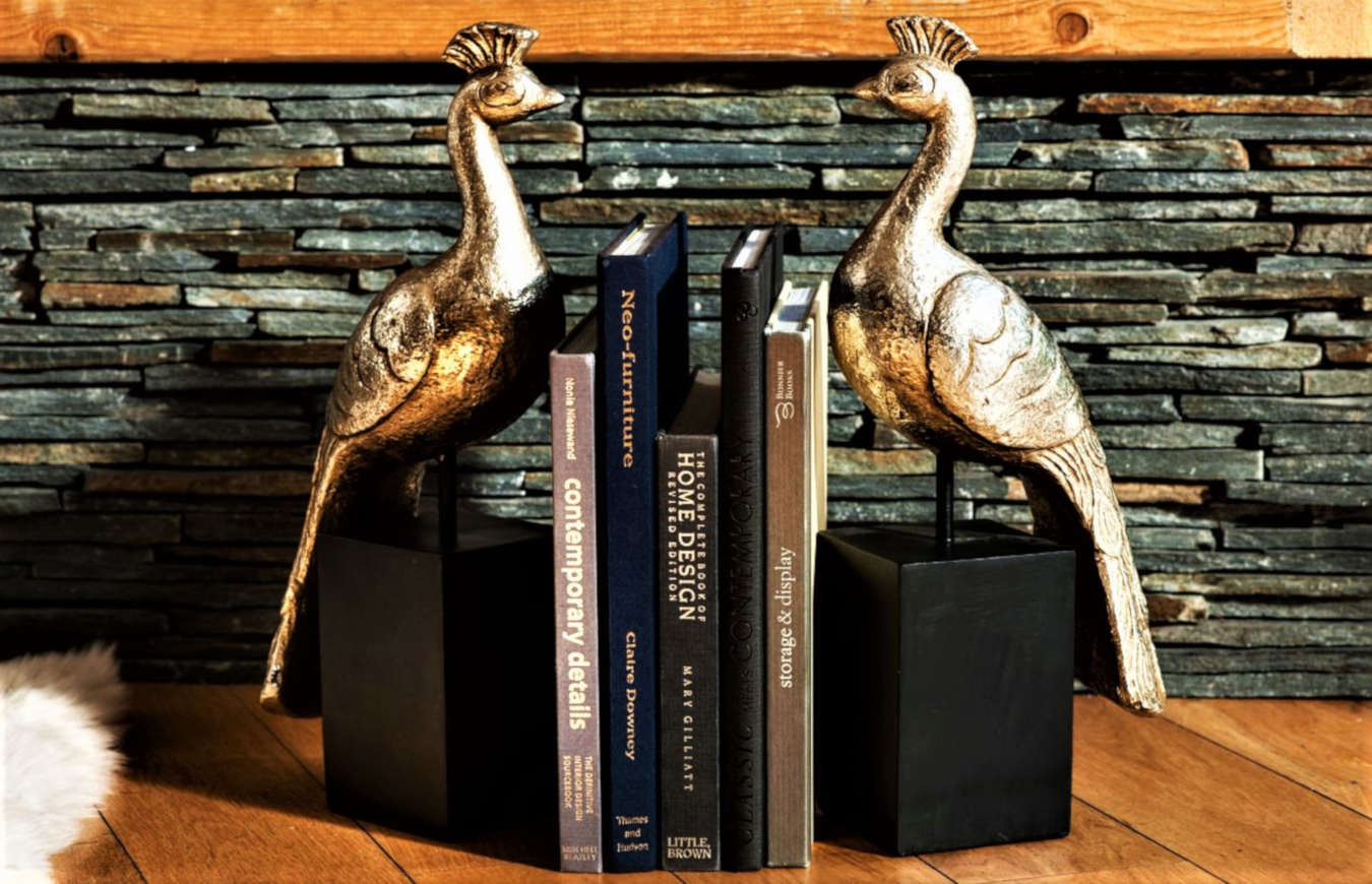 Luxury bookend decor on a shelf in a living room.