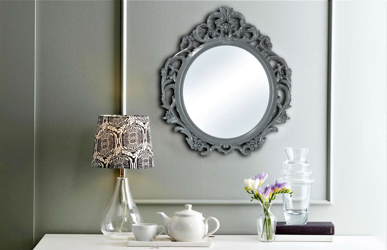 Luxury ornamental mirror in a living room decor.